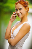 Girl with cellphone outdoors Royalty Free Stock Photos