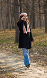 Girl on a cellphone in park Stock Photo