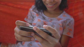 Girl with cellphone stock footage