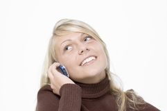 Girl / cellphone / white. Girl tossing head back and talking on a cellphone Royalty Free Stock Photo
