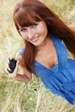 Girl with cellular phone Stock Photos