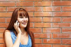 Girl with cellular phone Stock Images