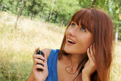 Girl with cellular phone Royalty Free Stock Image