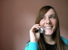 Girl with cellular phone. Smiling young girl with cellular phone royalty free stock photos