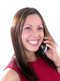 Girl With Cellular Phone. A young woman smiling as she listens on a cellular phone Stock Photos