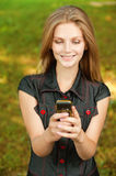 Girl with cellular telephone Royalty Free Stock Photos