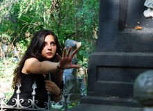 The girl on a cemetery. The girl-goth on a cemetery Royalty Free Stock Image