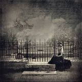 Girl cemetery sad. Sad young girl cemetery vintage fog moody Royalty Free Stock Image