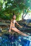 Girl in Cenote at Riviera Maya of Mexico. Girl bath in Cenote sinkhole at Riviera Maya of Mayan Mexico stock photography