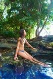 Girl in Cenote at Riviera Maya of Mexico. Girl bath in Cenote sinkhole at Riviera Maya of Mayan Mexico royalty free stock photo