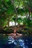 Girl in Cenote at Riviera Maya of Mexico. Latin girl bath in Cenote sinkhole at Riviera Maya of Mayan Mexico stock image
