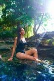 Girl in Cenote at Riviera Maya of Mexico. Latin girl bath in Cenote sinkhole at Riviera Maya of Mayan Mexico royalty free stock photography
