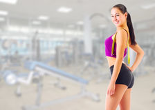 Girl with centimeter tape at gym club Stock Photo