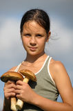 The girl with ceps Stock Photos