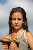 The girl with ceps. In hands Stock Images