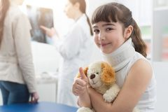 Girl with cervical collar in the doctor`s office stock photos