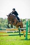 Girl chaild-rider show jumps Stock Photos