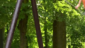 Girl on chain swings stock video