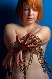 Girl with chains and padlock. Holding out her hands royalty free stock photos