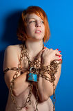 Girl with chains and padlock. Holding out her hands stock photos