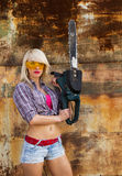 Sexy Girl holding a chainsaw Stock Images