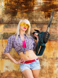 Sexy Girl holding a chainsaw Stock Photography