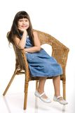 Girl on the chair. A photo of the girl sitting on the chair Stock Photography