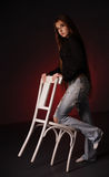 Girl with a chair Stock Photos