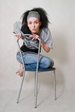 Girl on chair Stock Image