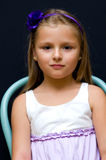 Girl on chair Royalty Free Stock Photography