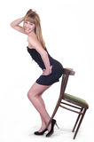 Girl with chair Stock Photo