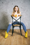 Girl on chair backwards Royalty Free Stock Photos