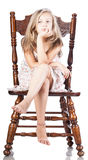 Girl on a chair isolated Royalty Free Stock Photos