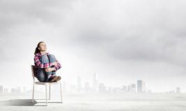 Girl in chair Royalty Free Stock Images