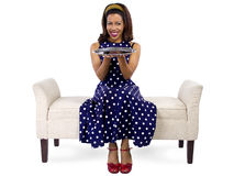 Girl on Chaise with Empty Tray. Young black girl holding an empty tray sitting on a chaise lounge stock photography