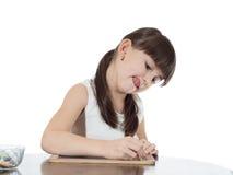 Girl and chalkboard Stock Image