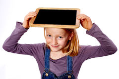 Girl with chalkboard. Young girl with a chalkboard on head stock photography