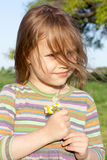 Girl with chamomile. Little girl at chamomile field Royalty Free Stock Photo