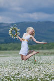 Girl in chamomile field Royalty Free Stock Image