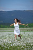 Girl in chamomile field Royalty Free Stock Photography