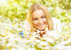 Girl on chamomile glade Royalty Free Stock Image
