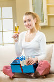 Girl with champagne and gifts Royalty Free Stock Photos