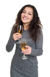 Girl with champagne glass beauty portrait, black and white checkered dress, long curly hair, glamour concept, isolated on white ba Royalty Free Stock Photos