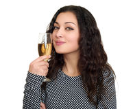 Girl with champagne glass beauty portrait, black and white checkered dress, long curly hair, glamour concept, isolated on white ba Royalty Free Stock Photography