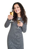 Girl with champagne wine glass portrait, black and white checkered dress, long curly hair, glamour concept, isolated on white back Stock Images