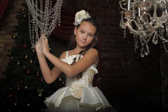 Girl and chandelier Royalty Free Stock Photography