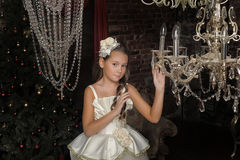 Girl and chandelier Stock Photography