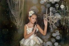 Girl and chandelier Stock Photo