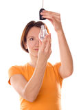 Girl change a light bulb Royalty Free Stock Photography