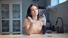 Girl changes batteries of a bionic hand, close up. One woman changes batteries in a prosthetic hand
